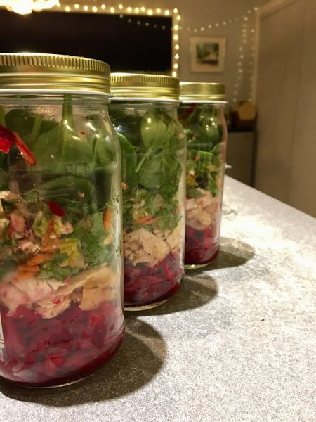 3 mason jars each filled with the best healthy spinach, beet, and chicken salad for meal prep