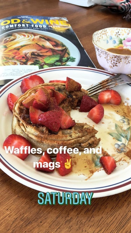 best healthy stack of waffles with fresh strawberries, cinnamon, and maple syrup on a plate with a cup of coffee and food & wine magazine