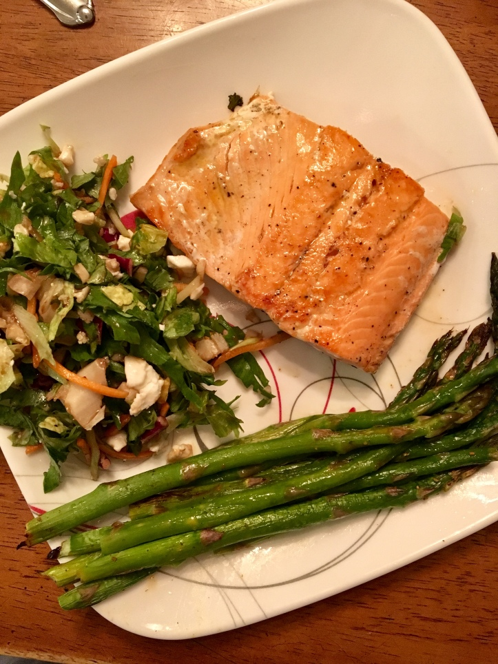 best healthy salmon with asparagus with a salad on a plate