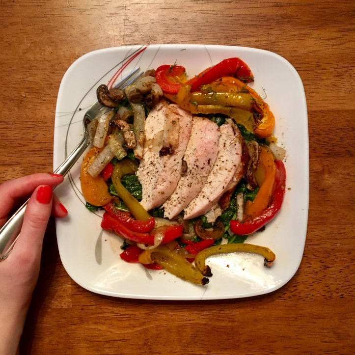 best healthy sheet pan chicken with peppers, onions, and mushrooms on a plate